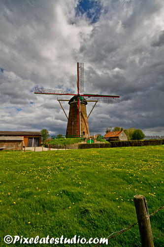 Dutch Windmill with cloudy sky