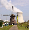 Windmill picture with the nuclaire powerplant of Doel Belgium on the background